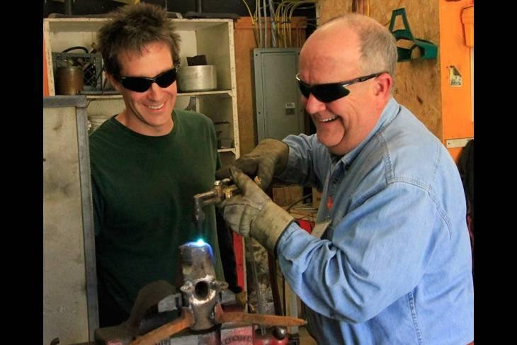 welding workshop, craft schools, older man learns welding