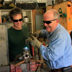welding workshop, craft schools, older man learns welding