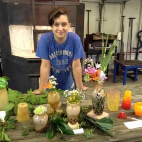 high school student glassblowing