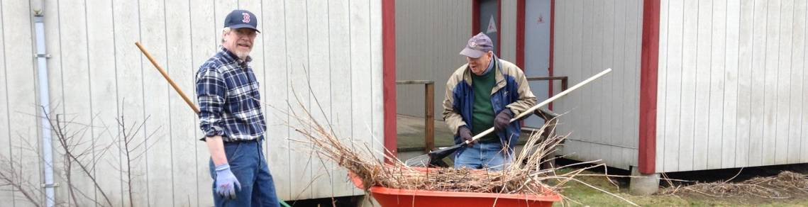spring cleanup, men in overalls, wheelbarrows